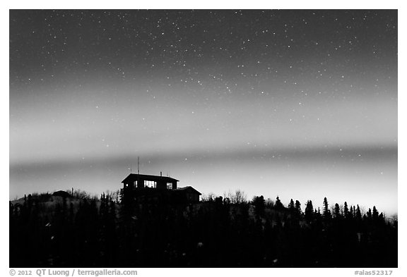 House and Northern Lights filled sky. Alaska, USA (black and white)