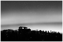 House and Northern Lights filled sky. Alaska, USA ( black and white)