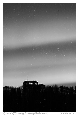 Hilltop house and Aurora Borealis. Alaska, USA (black and white)