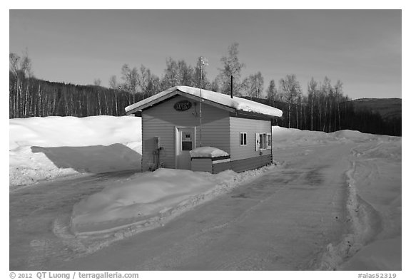 Drive-in coffee shop in isolated winter landscape. Alaska, USA (black and white)