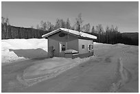 Drive-in coffee shop in isolated winter landscape. Alaska, USA ( black and white)