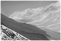 Snowy Arctic valley seen from Atigun Pass. Alaska, USA (black and white)