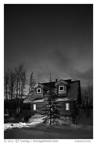 Cabin at night with Northern Lights. Wiseman, Alaska, USA (black and white)