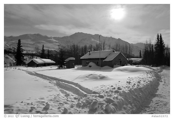 Backlit view of snow-covered village. Wiseman, Alaska, USA (black and white)
