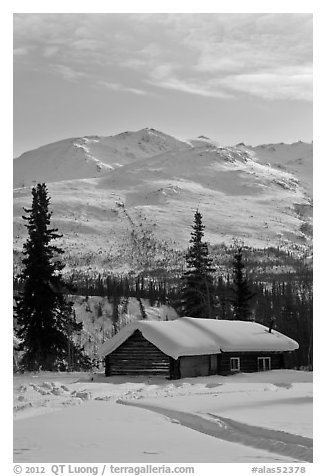 Snowy cabin and mountains. Wiseman, Alaska, USA (black and white)