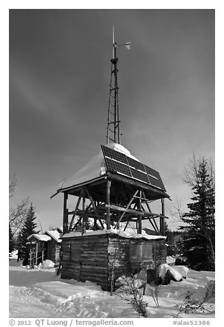 Tower with solar panels and windmill. Wiseman, Alaska, USA (black and white)