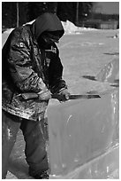 Ice artist carving with saw. Fairbanks, Alaska, USA (black and white)
