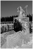 Girl on ice sculpture, George Horner Ice Park. Fairbanks, Alaska, USA (black and white)