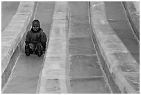 Girl on slide made of ice, George Horner Ice Park. Fairbanks, Alaska, USA (black and white)