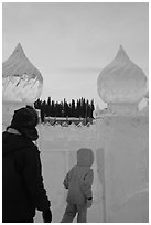 Family enters ice maze, George Horner Ice Park. Fairbanks, Alaska, USA ( black and white)