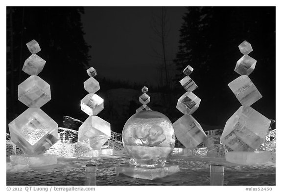 Balancing cubes made of ice at night, World Ice Art Championships. Fairbanks, Alaska, USA (black and white)