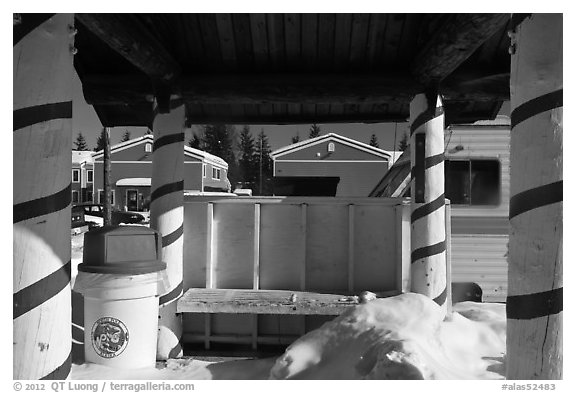 Bus stop with red candy-like stripped columns. North Pole, Alaska, USA (black and white)