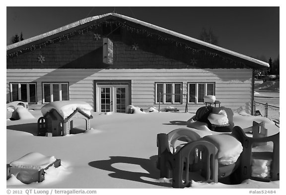 Playground in winter in front of day care. North Pole, Alaska, USA (black and white)