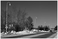 Main street and white street lights with red stripes. North Pole, Alaska, USA (black and white)