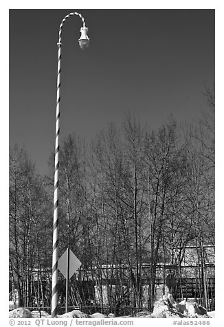 Street light decorated with a candy cane motif. North Pole, Alaska, USA (black and white)