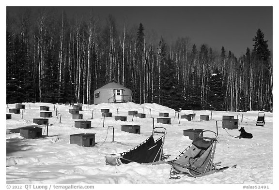 Sleds and kennel at mushing camp. North Pole, Alaska, USA (black and white)