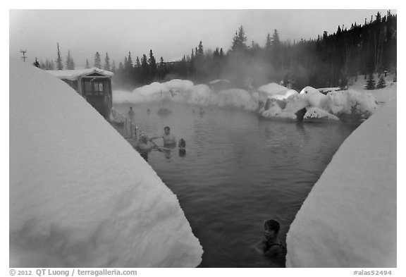 Soaking in natural hot pool surrounded by snow. Chena Hot Springs, Alaska, USA