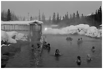 Popular outdoor hot springs, winter twilight. Chena Hot Springs, Alaska, USA ( black and white)