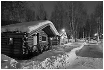 Path in snow and cabins at night. Chena Hot Springs, Alaska, USA ( black and white)