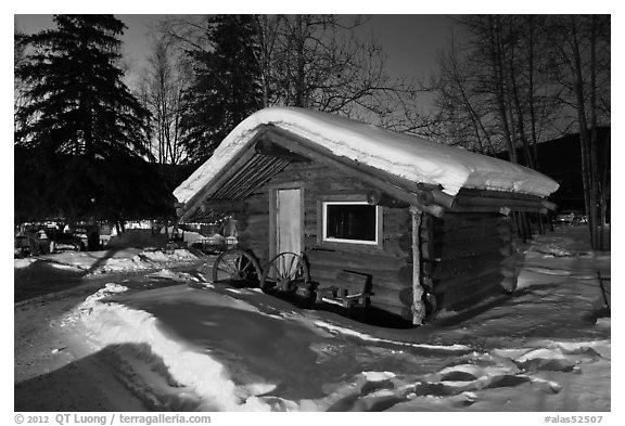 Snowy log cabin at night. Chena Hot Springs, Alaska, USA (black and white)