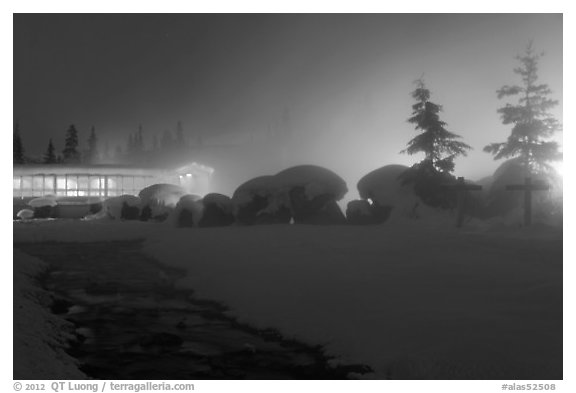 Stream, steam, and bathhouse at night. Chena Hot Springs, Alaska, USA (black and white)