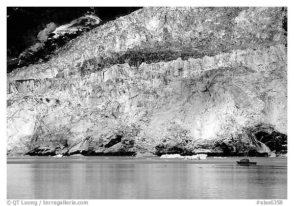 Boat at the base of Barry Glacier. Prince William Sound, Alaska, USA (black and white)