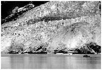 Boat at the base of Barry Glacier. Prince William Sound, Alaska, USA ( black and white)