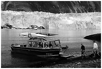 Water taxi boats lands on Black Sand Beach. Prince William Sound, Alaska, USA ( black and white)