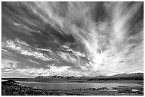Clouds, tundra and lake along Denali Highway. Alaska, USA (black and white)
