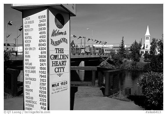 Sign showing distances to major cities on the globe in Fairbanks. Fairbanks, Alaska, USA (black and white)
