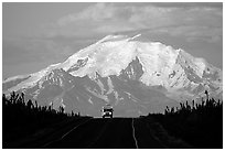 Car on Glenn Highway with Wrangell range peak behind. Alaska, USA (black and white)