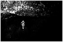 Caver inside a lava tube, Lava Beds National Monument. California, USA ( black and white)