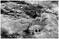 Kayakers on the rapids of the Trinity River, Shasta Trinity National Forest. California, USA (black and white)