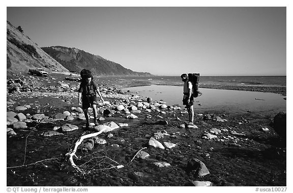 Backpackers cross a stream, Lost Coast. California, USA (black and white)