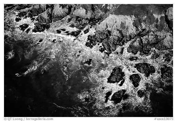 Aerial view of surf and rock. San Mateo County, California, USA (black and white)