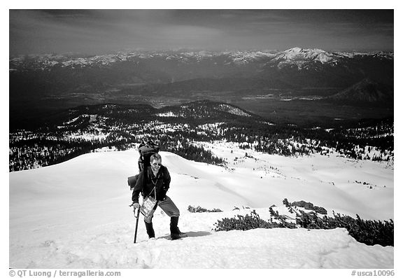 Climber takes a break on the Green Ridge of Mt Shasta. California, USA (black and white)