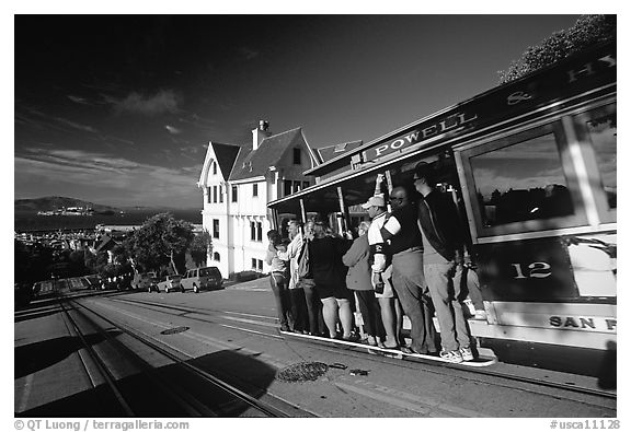 Cable car and Tudor house, Hyde Street, late afternoon. San Francisco, California, USA (black and white)