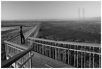 Man standing on boardwalk, Palo Alto Baylands. Palo Alto,  California, USA (black and white)
