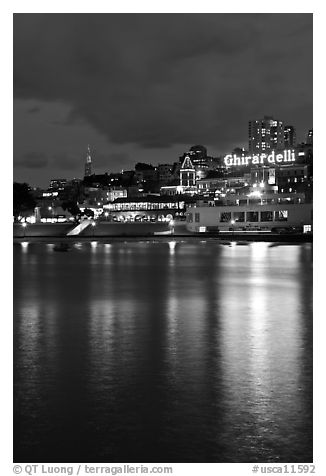 Lights of Ghirardelli Square sign reflected in Aquatic Park. San Francisco, California, USA (black and white)