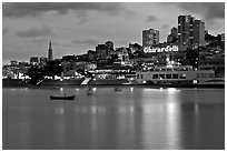 Aquatic Park, Ghirardelli Square, and skyline at dusk. San Francisco, California, USA (black and white)