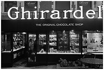 Ghirardelli chocolate store at dusk, Ghirardelli Square. San Francisco, California, USA (black and white)