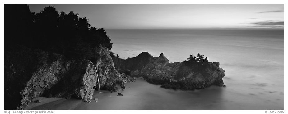 Seascape at sunset with coastal waterfall. Big Sur, California, USA (black and white)