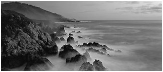 Seascape with pastel colors, rocks, and surf. Big Sur, California, USA (Panoramic black and white)