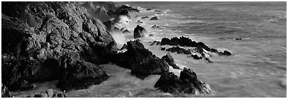 Rocky seashore, Garapata. Big Sur, California, USA (Panoramic black and white)