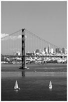 Sailboats, Golden Gate Bridge with city skyline, afternoon. San Francisco, California, USA (black and white)