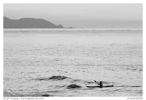 Sea kayaker, Rodeo Beach, sunset. California, USA (black and white)