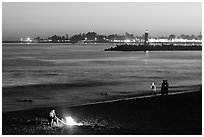Beach campfire at sunset. Santa Cruz, California, USA ( black and white)