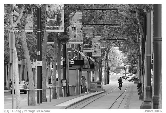 Downtown tree-lined street with tram lane. San Jose, California, USA (black and white)