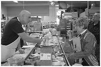 Choosing cheese at the Cheese Board. Berkeley, California, USA ( black and white)