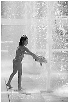 Girl refreshing herself, Cesar de Chavez Park. San Jose, California, USA (black and white)
